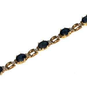 14k yellow gold oval faceted blue sapphire and diamond bracelet. 8 1/4