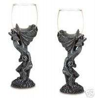 Two (2) medieval dragon glass goblets, dragons glasses